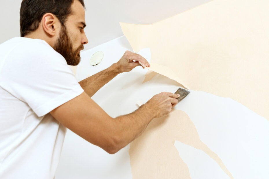 man removing wallpaper